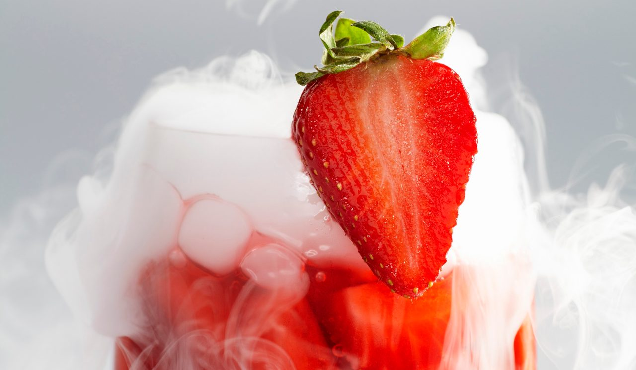 Strawberry punch in glass with dry ice mist